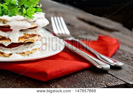 Zucchini Cake And Eating Utensils On A Red Napkin