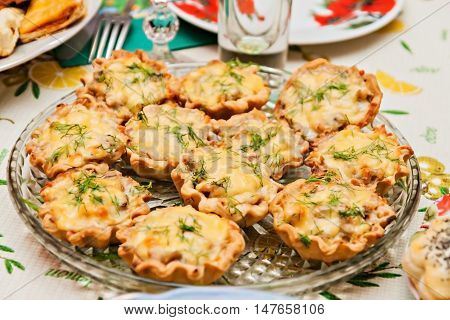 Tartlets With Cheese And Mushrooms On A Festive Table