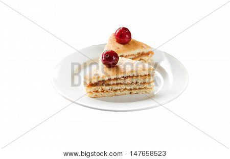 Sponge cake with cherries on a plate isolated