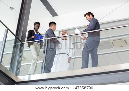 Young business people in hall of company