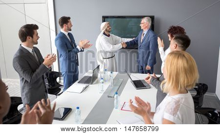 Arabian partner with director of company made successful business and handshake