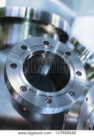 Industrial background, heavy metal housing with welded metal flanges. Shallow depth of field. Toning in the color blue industrial cold metal.