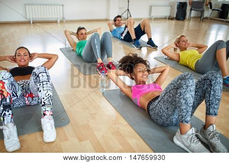 Group of women on fitness training on mats