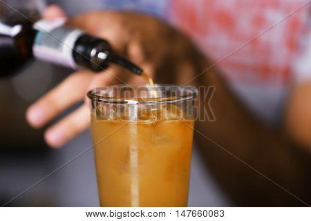 Barman preparing cocktail on bar counter