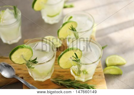 Cold fresh cocktails with lime on cutting board