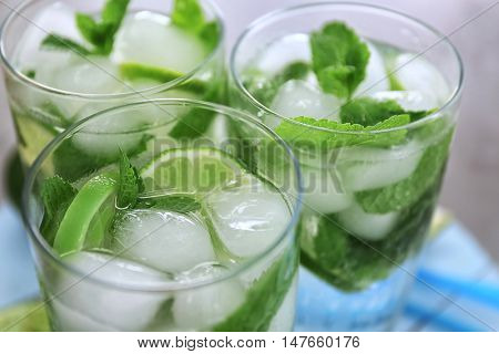 Cold fresh cocktails with lime, close up
