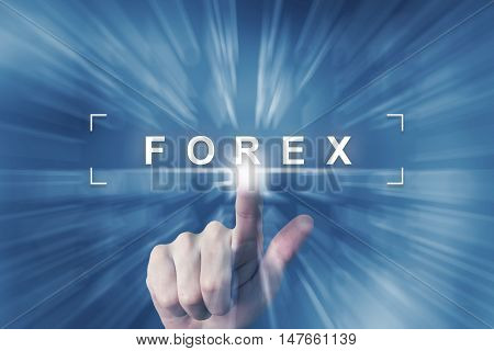 hand clicking on forex or foreign exchange button with zoom effect background
