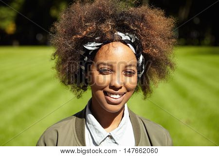 Outdoor Portrait Of Dark-skinned Girl On Sunny Day. Beautiful Trendy Hipster-looking Young Female Po