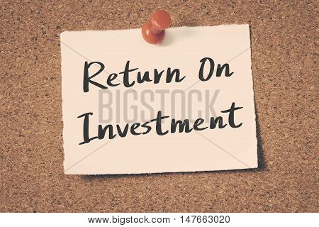 Return On Investment note pin on the bulletin board