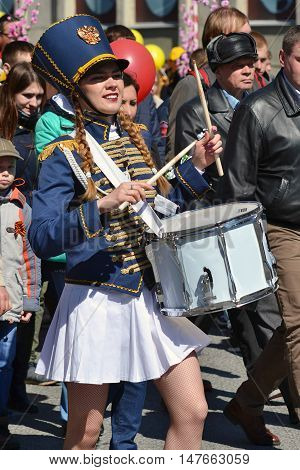 The girl the drummer with a drum at demonstration on May 9 2016 in Tyumen Russia