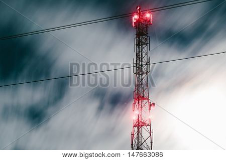 communication antenna tower. radio antenna tower. cell tower with red lights.