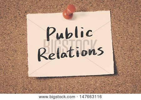 Public Relations note pin on the bulletin board