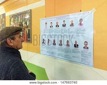 Moscow, Russia - September 18, 2016: Voters Examine The List Of Deputies In The Elections Of The Dum