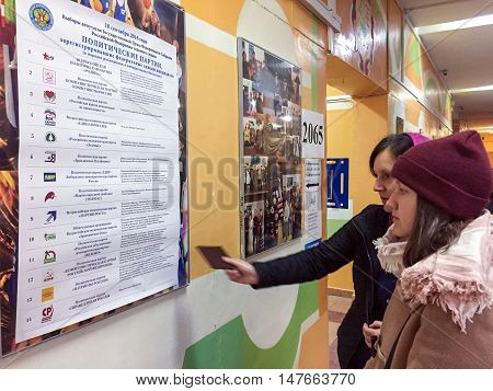 Moscow, Russia - September 18, 2016: Voters Examine The List Of Parties In The Elections Of The Duma