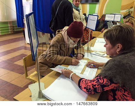 Moscow, Russia - September 18, 2016: The Voter Receives A Ballot For Elections Of Deputies Of The Du