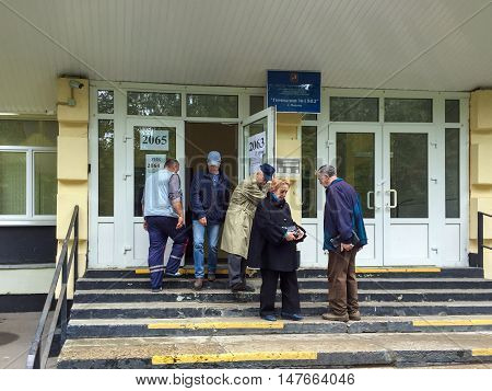 Moscow, Russia - September 18, 2016: Voters Enter A Polling Station To Take Part In Voting On Electi