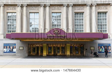CHICAGO - SEPTEMBER 5, 2016: Hilton Chicago. Entrance to the hotel that opened in 1927. Located on Michigan Avenue and overlooking Grant Park and Lake Michigan.
