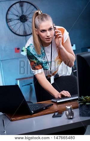 Young woman using computer and headphone.