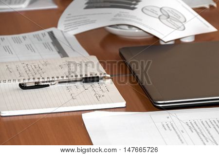 notes and folders on the table during the negotiations