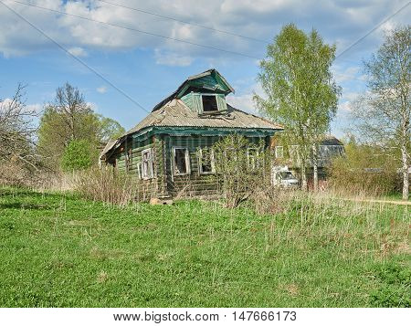 Abandoned old house in a village in Russia