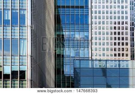 Office windows in Canary Wharf financial district of London