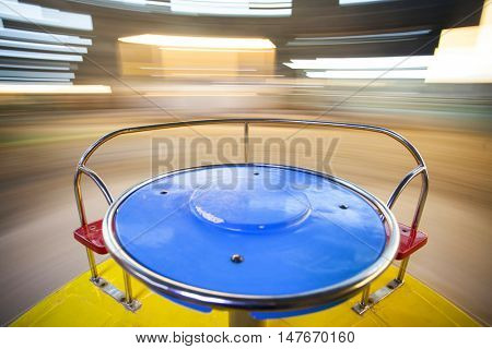 Rotating roundabout, carousel at the playground