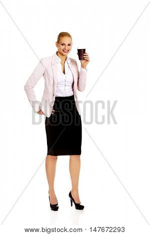 Business woman drinking coffee from paper cup