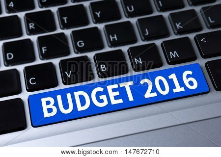 BUDGET 2016 a message on keyboard man hand top view use computer