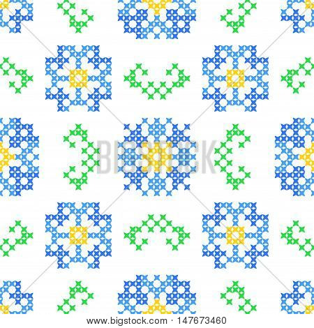 Seamless embroidered texture of abstract flat patterns, cornflowers with leaves, cross-stitch, ornament for cloth