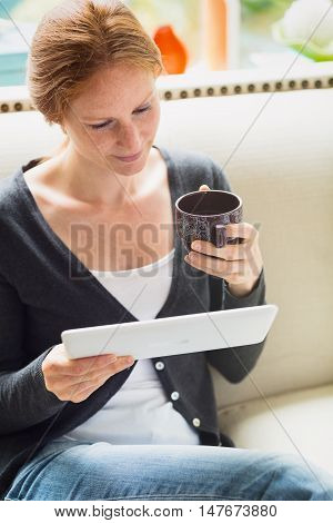 Woman Reading From A Tablet