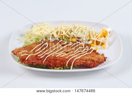 Dolly's Fish Fry with mixed vegetable salad on white background. Side view.