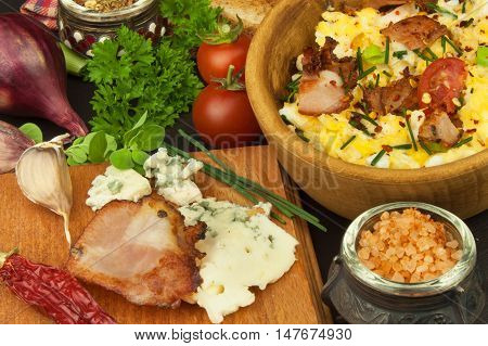 A breakfast full of protein. Scrambled eggs and bacon. A hearty meal for athletes. Homemade recipe for eggs.