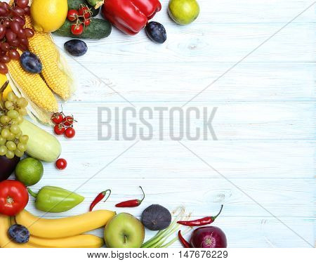 Ripe Fruits And Vegetables On Wooden Table