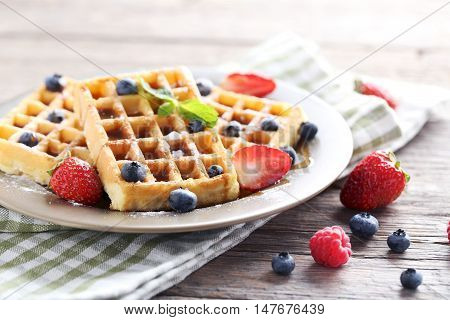 Homemade Waffles With Berries In Plate On Grey Wooden Table