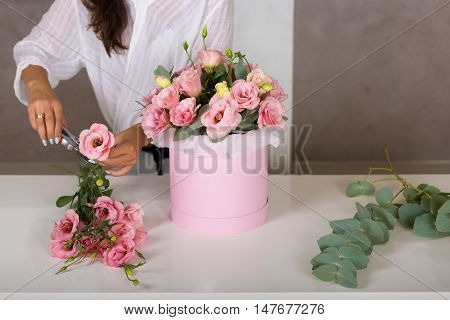 Woman Florist Making A Lovely Flower Composition