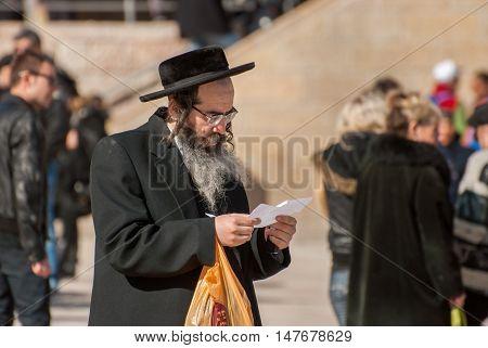 JERUSALEM ISRAEL - FEBRUARY 21 2012: Orthodox Jewish man near the Western Wall. Jerusalem. Israel