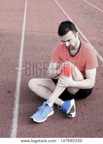 Runner With Injured Knee On The Track