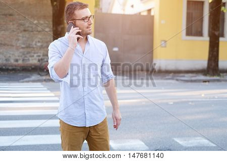 Man Calling On His Smartphone And Walking In The City Streets
