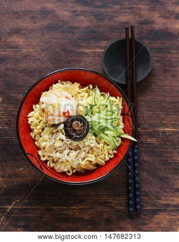 Asian food spicy ramen noodles with vegetables