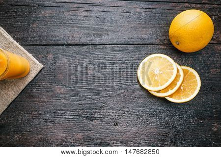 Fresh orange and homemade marmalade on the dark wood surface. Flat lay