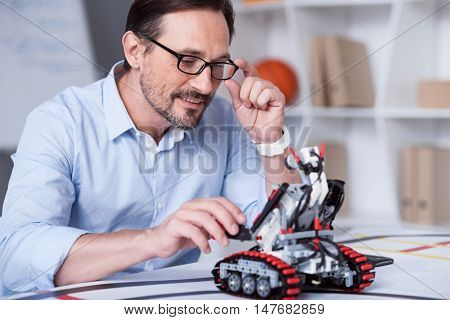 Science of Future. Male in glasses performing calculations with a help of new technologies
