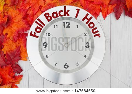 Fall Time Change Some fall leaves and a clock on weathered wood with text Fall Back 1 hour