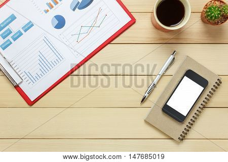 Top view chartered sheet pen coffee smartphone notebook cactus on office desk background.