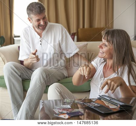 middle aged couple happy with their money situation