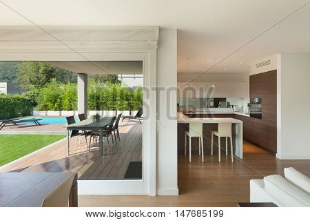 Luxury home interior, wide open space, veranda and garden view from the window