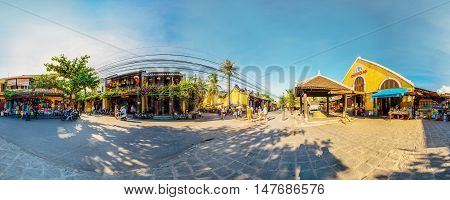 Hoi An, Vietnam - September 02, 2013: The tourists are walking in the street at Hoi An market in the afternoon