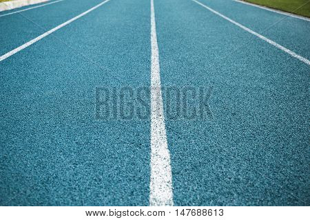 Close up of the blue lanes on a running track