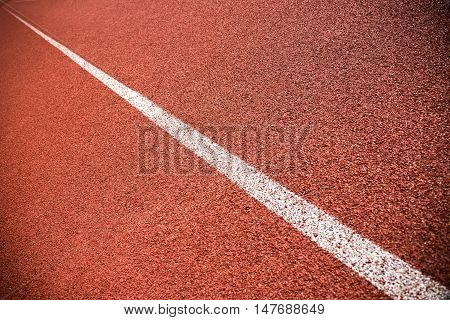 Close up of the red lane on a running track