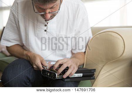 middle east man fixing an external hard drive