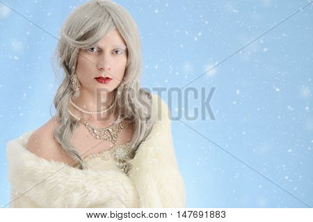 portrait of woman wearing fur cloak with snow
